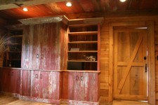 The cabinets are made from reclaimed crackled red barn boards.