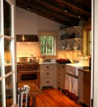 A fully equipped kitchen and restroom were added in a shed addition off the back of the cabin.