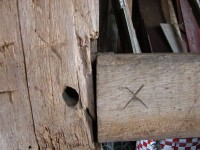 Marriage marks, here the Roman numeral X, were used by early craftsmen to label the timbers in preparation for the barn's  first raising, circa 1780.