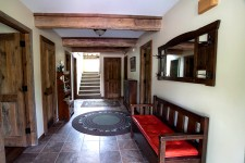 The main entry opens into a common area between 3 bedrooms.  The stairs in the back access the main living area upstairs.