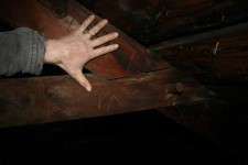 Marriage marks, Roman numerals carved to label the parts by the original craftsman, are clearly visible on the rafters.