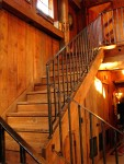 Heritage Restorations built the staircase of reclaimed vintage barn wood.  Our traditional blacksmithing shop hand-forged all the custom iron railings.