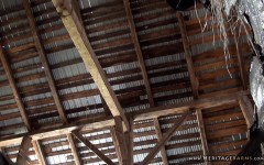 This barn has very long, single piece, hand-hewn rafters.
